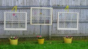 Image of Outdoor Fence Decoration With Upcycled Glass Window With