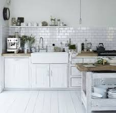Tile In The Kitchen - classic subway tile and casual wood shelving makes this kitchen