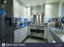 a small modern domestic kitchen with a fridge freezer range