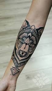 collection of 25 grey wolf and lettering tattoos on forearm