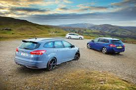 peugeot estate cars ford focus st estate vs peugeot 308 sw and seat leon estate