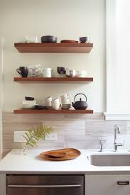 sublime oak wood wall floating shelving units above cabinet with