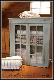 my cabinet place quilt cabinet makeover blanket storage chicken wire and glass doors