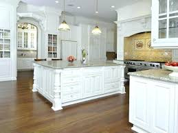 white kitchen cabinets with light hardwood floors distressed wood