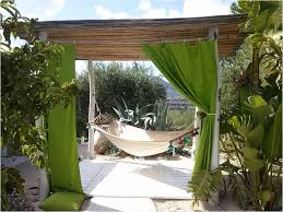 Pergola Designs For Patios by Terrace Garden Design Striped Canopy Above Dining Table Set In