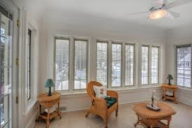 sunroom windows sunroom window replacement traditional porch grand rapids