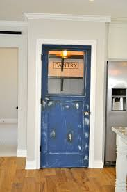 vintage door repurposed as a pantry door by rafterhouse
