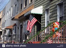Stars Houses Christmas Decorations And Stars U0026 Stripes Flag Outside Domestic