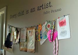 hanging kids artwork every child is an artist i like the quote on the wall but the