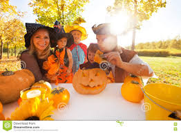 family in halloween costumes craft jack o u0027 lantern stock photo