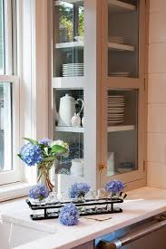 gray glass front cabinets with white shelves transitional