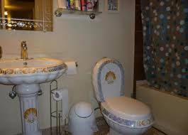 seashell themed bathroom pedestal sink toilet bowl tank in