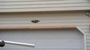 Overhead Door Stop by Installing Aluminum Casings Covering Over Wood Garage Door Jambs