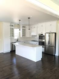 top design must haves when building a home the hoffman s went with a very neutral palette with designing a white kitchen and adding timeless design pieces such as black cabinet hardware and white