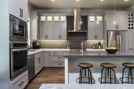 green kitchen cabinets with white island light gray cabinetry complements white island in sleek