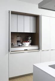 Grey Bifold Kitchen Cupboard Doors Reveal Wooden Shelving Inside - Bifold kitchen cabinet doors
