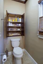 organizing small bathroom space decorative plant in a tube glass