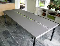 concrete and wood dining table concrete rock dining table by trueform concrete contemporary