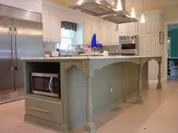 white kitchen island with black granite top beige painting cabinet with beige granite top white ceramic tile