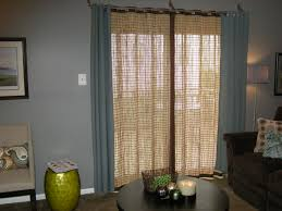 brown pandanus woven blind for sliding door cover placed on blue