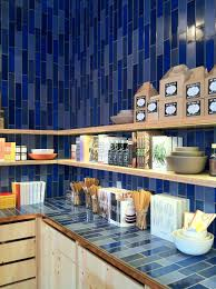 floating shelves and vertical tile backsplash at heath ceramics
