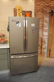 photos hgtv wood paneled refrigerator with industrial touches in french door refrigerator slate and appliances on pinterest interior wall ideas how to get