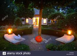 halloween pumpkin light lights in a garden candle candles candlelight green tree trees
