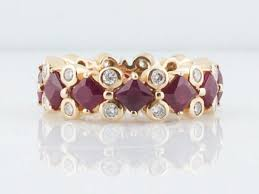 ruby band mid century shared prong set 6 36 ruby band with bezel set diamonds