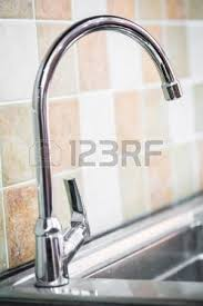 stainless steel kitchen faucet and sink with running water stock