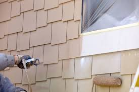how much exterior paint to use spraying vs brushing