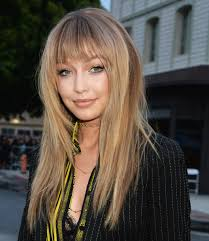 best haircut for long curly hair find the perfect bangs for your face shape instyle com
