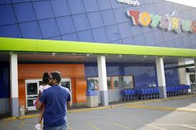 toys r us siege social bankrupt toys r us weighs closing at least 100 stores bloomberg
