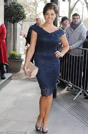 in the navy jessica wright squeezes her ample curves into blue