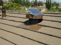 20 watt natural light solar attic fan installed in metal tile roof