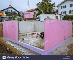 Prefabricated House Prefabricated House Workers In Setting Up The Basement Walls On