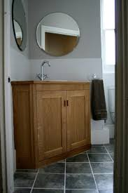 Corner Bathroom Vanities And Cabinets by Attractive Oak Corner Bathroom Vanity Units Using Shaker Style