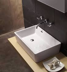 Hanging Bathroom Vanities by Alluring Wash Basins For Bathrooms In White Accent On Wooden