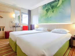 Bed With A Lot Of Pillows Hotel In Roissy En France Ibis Styles Paris Roissy Cdg