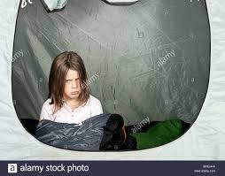 shot of a young looking unhappy about camping stock photo