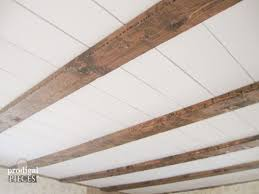 Fake Ceiling Beams by A Very Simple Diy Reclaimed Barn Wood Beam Cover Cover Up That