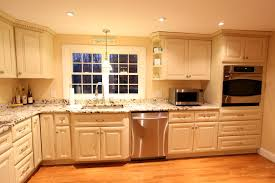 wood countertops antique white kitchen cabinets lighting flooring