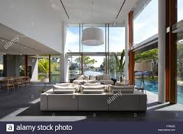 open plan double height living room modern white house israel open plan double height living room cove way house sentosa singapore stock
