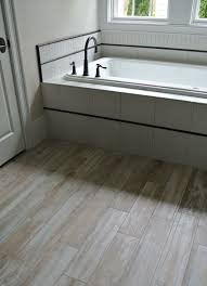 Ideas For Bathroom Floors Pebble Tile Bathroom Flooring Ideas Managing The Tile To Wood