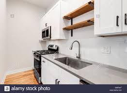 small kitchens with white cabinets a small kitchen in a chicago condo with white cabinets and