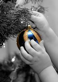 sweet toddler hands hanging christmas ornament photography