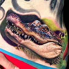 alligator v crocodile tattoos inked magazine inked magazine