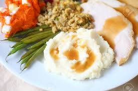 thanksgiving meal with turkey mashed potatoes green