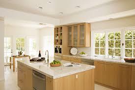 modern kitchen features white oak cabinet white limestone floors