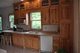 hickory cabinets and pine tongue and groove ceiling in kitchen