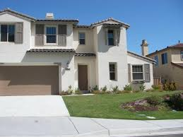 white exterior house color combination with brown garage door for